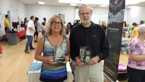 Lee is pictured with Dr. John Moss. Author of Quin and Morgan novels.